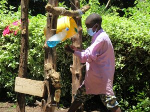 Person uses a tippy tap handwashing station. Photo courtesy of Well Beyond