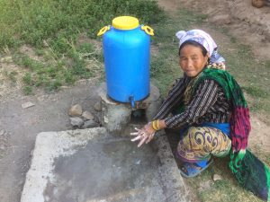 Woman washes her hands in Nepal at a handwashing station