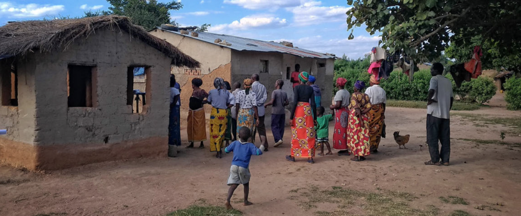 A community health club gathers to visit households and learn about solutions for safe water, sanitation and hygiene
