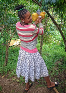 A community member of Abeshege, Ethiopia demonstrates her homemade handwashing station and proper technique